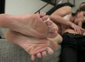 Dark haired sex industry star footjob..