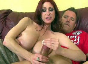 Big-boobed red-haired mummy hand job