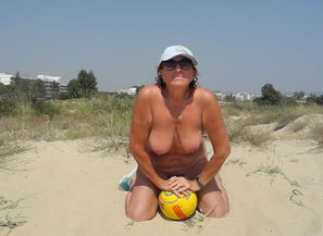 Naked with ball on the beach